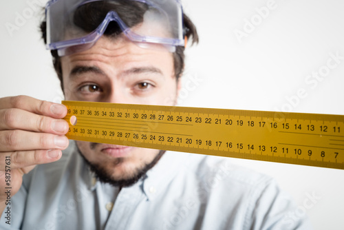 young man bricolage working measuring with meter