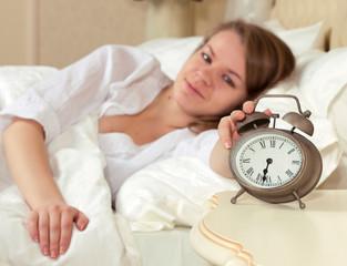 Woman's hand off the alarm clock