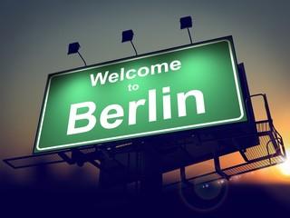 Billboard Welcome to Berlin at Sunrise.