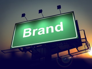 Brand on Green Billboard at Sunrise.