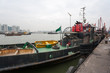 Постер, плакат: Tugboat and fishing vessels are at berth in the port of Macao