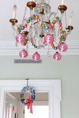 Christmas balls hanging from the chandelier