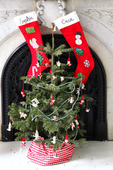 Christmas stockings hanging from fireplace mantel