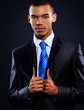 Portrait of African American businessman with arms together