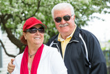 Easygoing Positive Senior Adult Couple in Sports