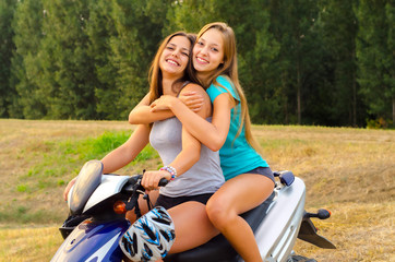 Two beautiful girls enjoying motorcycle ride