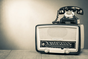 Vintage old radio and telephone sepia photo