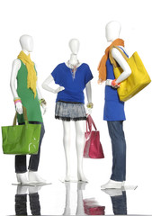 full-length female clothes with bag on three mannequin