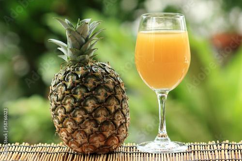 Fototapeta Fresh pineapple and juice