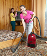 Women cleaning  in home