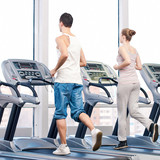 Woman and man at the gym exercising.