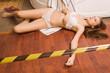 Crime scene simulation. Lifeless girl lying on the floor