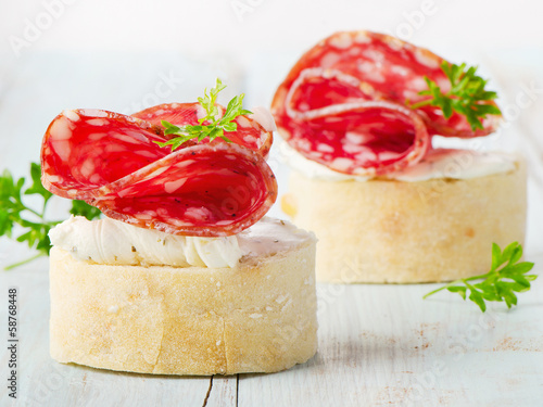 Baguette with bacon and cream cheese with herbs.