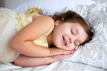 Happy smiling kid sleeping and smiling