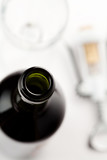 Close up of wine bottle with corkscrew and glass