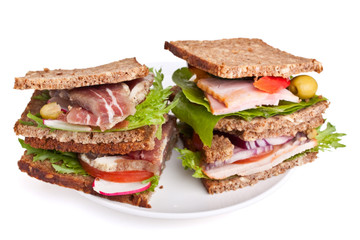 whole grain bread sandwiches with pork, poultry and vegetables
