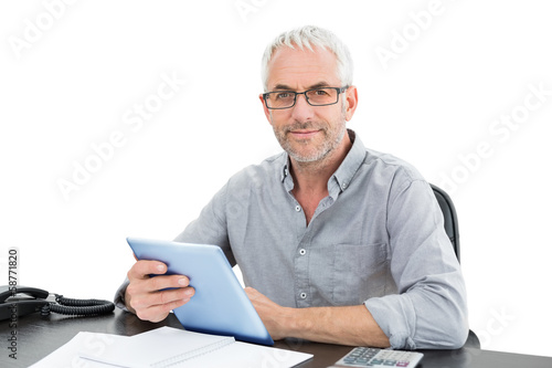 Portrait of a mature businessman with digital tablet and telepho