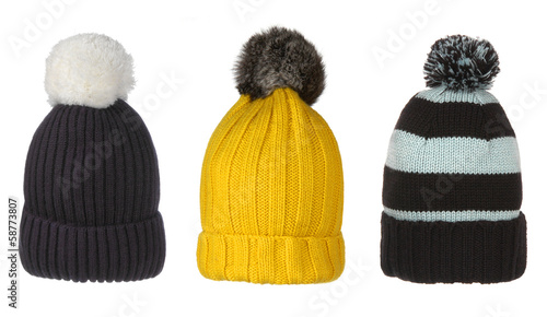 set of winter hats with pompon isolated on white