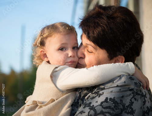 Little girl embracing with grandmother