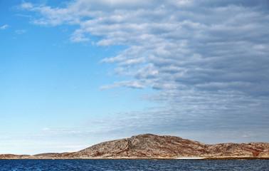 Atmospheric front. Stormy clouds go over Norwegian sea coast