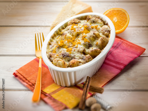 gnocchi gratin with nutmeg and orange peel, selective focus