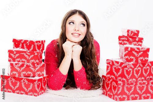 smiling woman with many gift boxes isolated on white