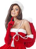 Christmas hispanic woman wearing a santa hat smiling