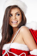 Christmas hispanic woman wearing a santa hat smiling
