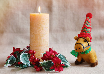 Orange candle and toy horse