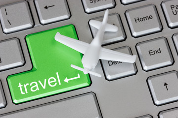 Plane  on keyboard with travel button