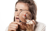 girl squeezing her pimples using magnifying glass poster