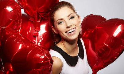 beautiful young woman with a heart-shaped balloons