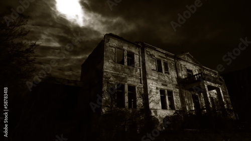 Abandoned rustic hotel at night