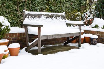 Garden bench in snow