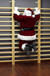 santa claus exercising with wall bars,Christmas Time preparation