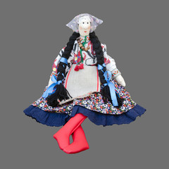 Sitting solated handmade doll in the national Ukrainian costume