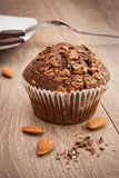 Delicious chocolate muffin with almonds and caramel
