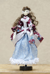 Handmade doll in a ball gown