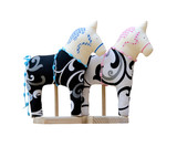 Hand made soft toy horse couple isolated on the stands