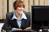 Female support assistant working at the helpdesk
