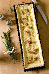 quiche with green vegetables, herbs and bacon.