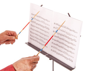 music director with baton and sheet stand
