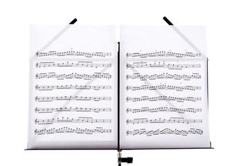 music stand with melody sheets