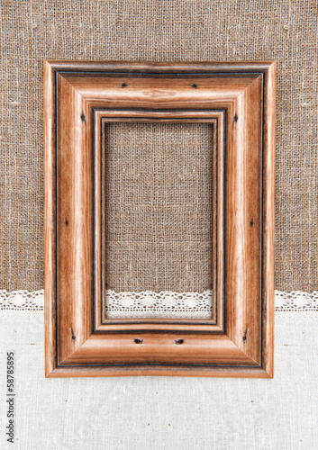 Aged wooden frame on the burlap