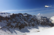 Helicopter in snowy sunny mountains