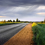 Rural road  before the rain. Panorama.