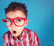 Surprised five years old boy wearing glasses