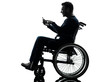 handicapped man in wheelchair silhouette