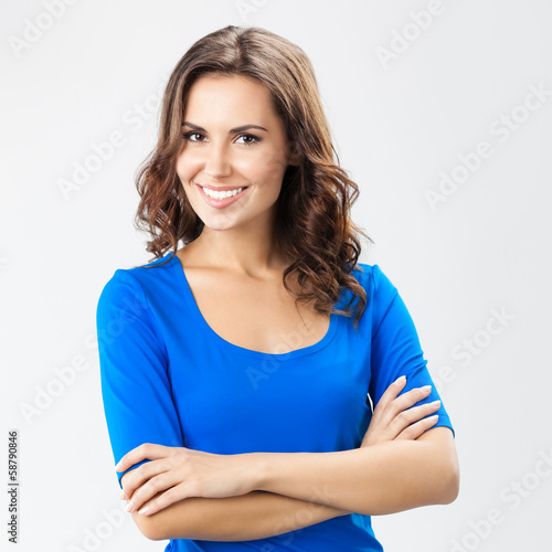 Happy smiling young woman, over grey