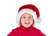 Happy cute little girl with Santa hat
